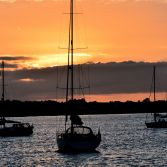 Yacht silhouettes at sunset