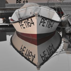 Fishing boat reflection