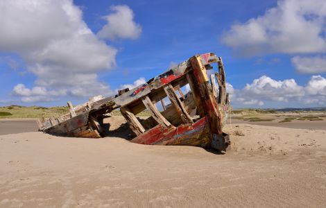 Fishing boat wrecked on the beach