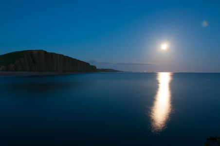 Moon over East Cliff, West Bay