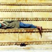 Man resting on the stairs - India