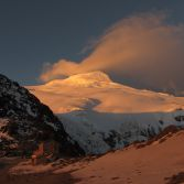 Volcan Cayambe Summit and refuge at Sunset