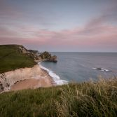 Durdle Door under magenta sky