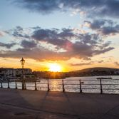 Sunset and sun rays over seaside town Swanage