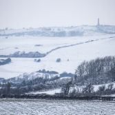 Snowy hills and Hardy monument