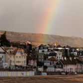 Rainbow and beach huts